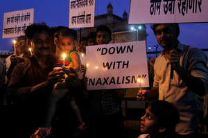 Congress Party leaders say the ambush in Chhattisgarh was an attack on democracy. The placard at the right reads 'Congress stands strongly against Naxalism'. Photo / AP