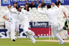 England's Ian Bell (left) celebrates after dismissing New Zealand's Doug Bracewell.  Photo / AP