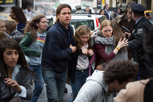 Mireille Enos with Brad Pitt and Abigail Hargrove in World War Z. Photo / Supplied