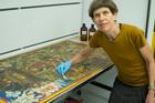 Sarah Hillary restoring a tanka painting. Photo / Supplied