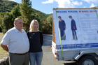 Bob Stewart, left and his daughter Jane Galanakis next to a billboard at the Rimutaka Forest Park, where Kaye Stewart, the wife and mother went missing two years ago. Photo / APN