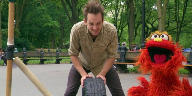 Kiwi Joseph Herscher makes a plant-watering machine out of a car tyre on Sesame Street. Photo / Supplied