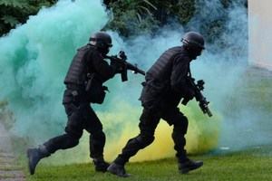 Members of the Brazilian Navy take part in a terrorist attack drill dealing with chemical weapons as part of the security measures for the upcoming FIFA Confederations Cup. Photo / AFP