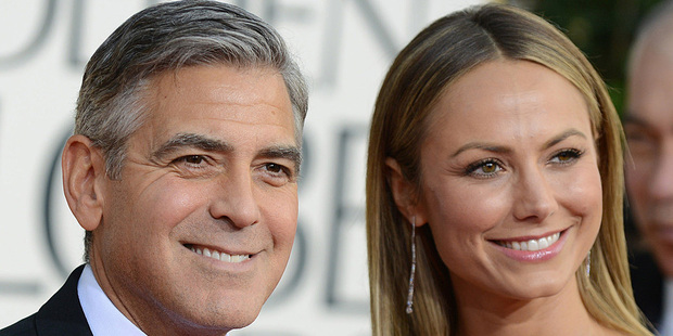 George Clooney and Stacey Keibler at the Golden Globes. Photo/AP