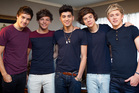 Zayn Malik, centre, and his One Direction bandmates. Photo/Sarah Ivey