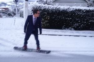 Scott Cardwell snowboarding to work in Dunedin. Photo / Supplied