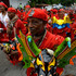 Men dressed as a dancing devils perform on the streets in San Francisco de Yare, Venezuela. Photo / AP