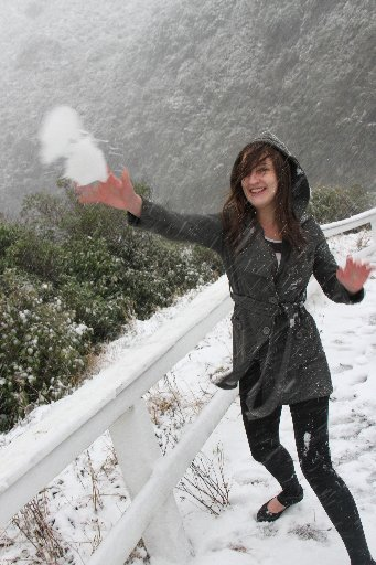 Snow falls at the top of the Rimutaka Hill Rd, forcing several closures throughout the day. Elena Lynch, Featherston, takes time out to lob snowballs at her friend.