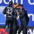 Wicketkeeper Luke Ronchi of New Zealand (R) congratulates Kane Williamson for running out Tim Bresnan. Photo / Getty Images
