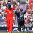 Kane Williamson of New Zealand congratulates Luke Ronchi for stumping Chris Woakes. Photo / Getty Images