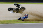 France's Randy De Puniet crashes during a free practice session for Sunday's Italian Moto GP, at the Mugello race circuit. Photo / AP