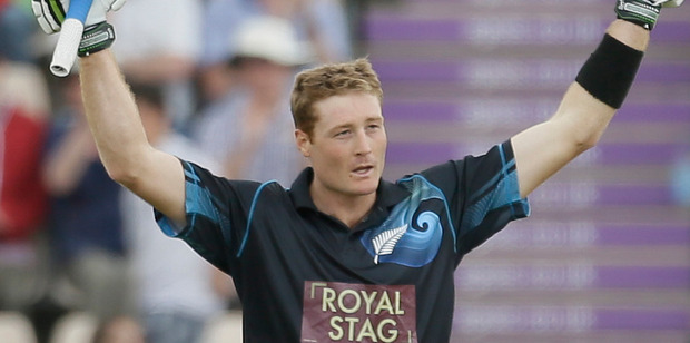 Martin Guptill celebrates scoring 100 against England during their second one day international cricket match at the Ageas Bowl in Southampton, England. Photo / AP
