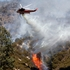 A helicopter drops water on hill fire to fight what has been called the Powerhouse fire in the rural community of Lake Hughes in northern Los Angeles County, California. Photo / AP