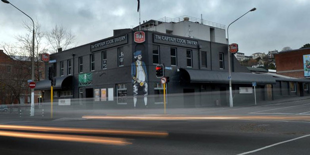 Lights from passing cars are captured outside Dunedin's Captain Cook Tavern, which is facing closure this month. Photo / ODT