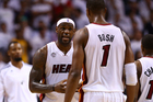 LeBron James #6 talks to Chris Bosh #1 of the Miami Heat. Photo / Getty Images.