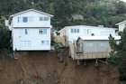 Houses on Priscilla Crescent balance on the edge of a slip in Kingston, Wellington. Photo / Hagen Hopkins