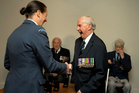 Ron Mayhill receives the Bomber Command Clasp from Wing Commander Lisa D'Oliveria.  Photo / Brett Phibbs
