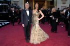 Michael Douglas, pictured with wife Catherine Zeta-Jones at this year's Oscars, is confident he has beaten throat cancer.  Photo / AP