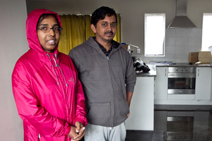 Simna Nair and Sajeev Puthussery spent the night with friends after water flowed through their rented house in Don Buck Drive, soaking their bed, the sofa and the carpets.  Photo / Natalie Slade
