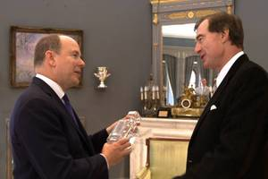 Kiwi businessman Craig Heatley presents Prince Albert of Monaco with whisky and a decanter. Photo / Supplied
