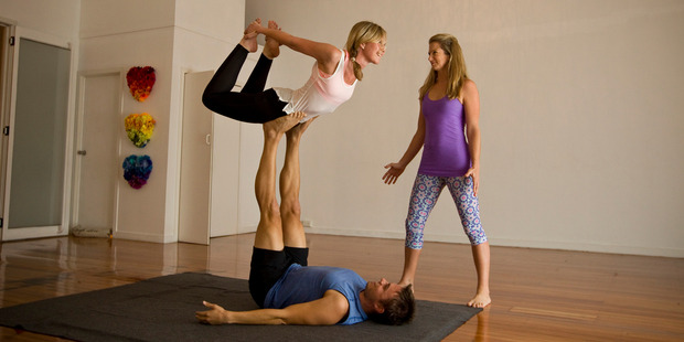 Rachel Grunwell samples acro yoga, a mix of yoga and acrobatics. Photo / Michael Craig