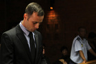 Oscar Pistorius spends his time 'reading the Bible, praying and working out'. Photo / AP