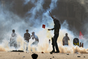 Anti-government protesters clash with riot police at the city's main Taksim Square in Istanbul. Photo / AP