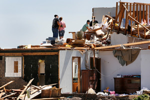Union City residents search for whatever can be salvaged from the ruins of a home hit by Saturday's tornado.  Photo / AP