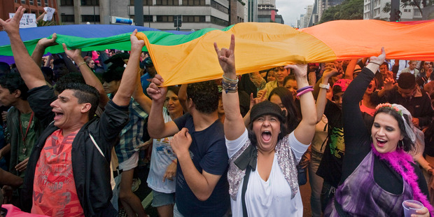 Participants hold a rainbow flag as they march during the annual Gay Pride Parade in Sao Paulo, Brazil. Photo / AP