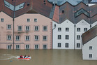 The Red Cross in Passau, Germany, negotiate flooded streets in boats. Photo / AP