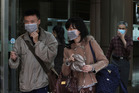 Taiwanese people wear masks at National Taiwan University Hospital in Taipei, Taiwan. Photo / AP