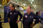 Pilots Andre Borschberg, co-founder and CEO, and Dr. Bertrand Piccard, chairman, talk with reporters as the Solar Impulse sits in a specially made hangar. Photo / AP