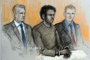 Court sketch of Michael Adebowale, flanked by two police officers in the dock, during his appearance at Westminster Magistrates. Image / Elizabeth Cook / AP