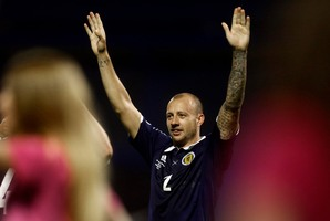 Scotland's Alan Hutton celebrates his team's victory over Croatia in their group A World Cup qualifying soccer match in Zagreb, Croatia, Friday, June 7, 2013. (AP Photo/Darko Bandic)