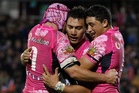 Nathan Friend (left) and Kevin Locke (right) celebrate a try by Elijah Taylor (centre). Photo / Richard Robinson