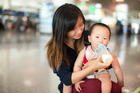 A mother feeds her baby at shopping mall in Beijing. Booming demand for NZ infant formula means inexperienced companies are trying to cash in - putting our reputation at risk, says the industry's big players.  Photo / David White.