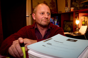 Paul Shann pictured at home in Puketapu with a large amount of ACC paperwork. Photo / Glenn Taylor
