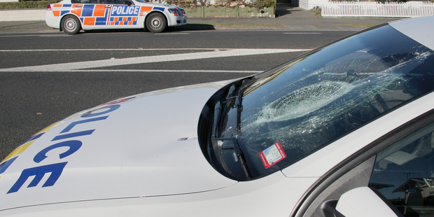 The man who smashed this police car windscreen with a dive bottle wants it back.  Photo / Warren Buckland