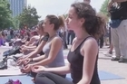 Protesters who have been occupying Istanbul's Gezi park for six days in an effort to save it from the bulldozers take to mass yoga as a new form of protest.