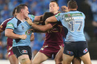 Paul Gallen of the Blues punches Nate Myles of the Maroons during State of Origin I. Photo / Getty Images