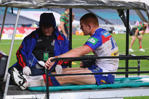 Newcastle's Alex McKinnon is taken from the field after being injured in an alleged 'cannonball' tackle. Photo / Getty Images