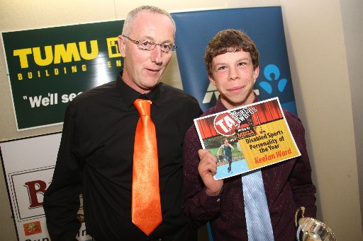 The Wairarapa Sports Awards 2013. Winner of the Disabled Personality of the Year is Keelan Ward (right), pictured with Mitre 10 Mega general manager Brent Stewart. Keelan also received $1000 from Mitre 10 Mega to further his sporting goals.