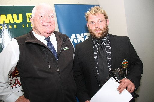 Wairarapa Sports Awards 2013. Senior Sports Team of the Year is Wairarapa Bush Heartland Rugby. Sponsor Peter Allan, X Country Rentals (left) stands with prop Kurt Simmonds.