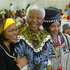 Former South African President Nelson Mandela, center, with his wife Graca Machel, left, and his former wife Winnie Madikizela-Mandela, at his 86th birthday party in Qunu, South Africa, July 18, 2004. Photo / AP