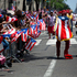 A parade participant skates by a New York City police officer during the National Puerto Rican Day Parade in New York. Photo / AP