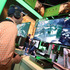 An E3 2013 attendee interacts with Ryse: Son of Rome for Xbox One at Microsoft's booth at E3 2013 in Los Angeles. Photo / AP