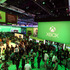 E3 2013 attendees interact with newly announced games and experiences for Xbox One at Microsoft's booth at E3 2013 in Los Angeles. Photo / AP