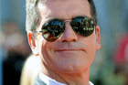 Simon Cowell was egged by a stage intruder during the live finale of Britain's Got Talent. Photo / AP