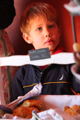 Finlay Brenstrum, 5, Martinborough, eyes up the cake stall.
