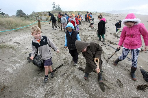 Whareama School children head out to the planting site in the sand dunes at Riversdale beach.